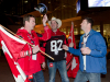 TORONTO, Ont. (25/11/2012) - Calgary Stampeders fan Mike Gusella (L) tries on Steven Anderson's Argos hat while friend Ken Brown (centre) watches during the 100th Grey Cup in Toronto, Ontario on November 25, 2012. Photo by Marta Iwanek.