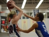 Loyalist rookie Alex Aguiar looks for an open teammate while being guarded by former Lancer Amber Burton. Photo by Taylor Renkema.