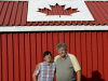 TRENTON ONT (27/06/2011) Ted Sargent and his wife Maureen Sargent stand in front of their Canada flag themed shed. Ted built the shed partly as a competition with his neighbor. Who could be more patriotic? He also hoped that CFB Trenton pilots could see it from the air. He once asked a pilot if he could see it, but the pilot said he was to busy looking for the runway. For Maureen showing off the Canadian flag is also to honour her father who fought in the Second World War. Photo by Linda Horn