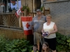 "TRENTON ONT (27/06/2011) Nancy and Karl Reid stand with their step grandchildren Selina and Dalton. Nancy holds a picture of her son Jonathan and her late daughter- in- law Andrea. The Reids fly a permanent Canadian flag, but the the temporary flags have a lot more meaning. They are put out in honour of Andrea who became a Canadian citizen on Canada day five years ago. Andrea passed away on May 26 2011 from an infection. ""She loved seeing her flags out on Canada day,"" said Nancy Reid. ""She thought Canada was the best country on earth,"" said Karl Reid. Photo by Linda Horn"
