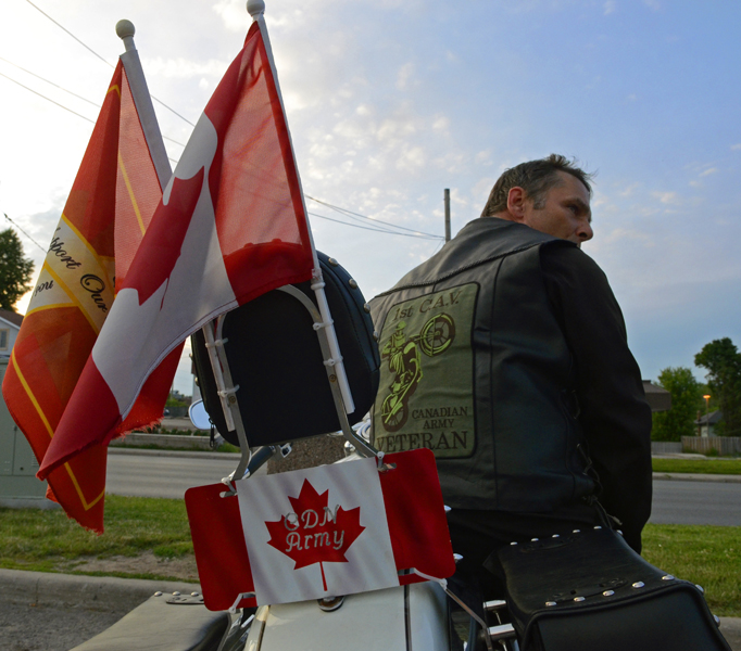 TRENTON ONT (27/06/2011) For Lance Usher flying the Canadian flag is important because he served under it for 24 years. Usher is now retired and still supports the military by participating in the 1st Canadian Army Veteran motorcycle group events. One of the events the group takes part in is any repatriation ceremonies. Currently his son is serving in the Canadian military making him 4th generation in the Usher family to serve. Photo by Linda Horn