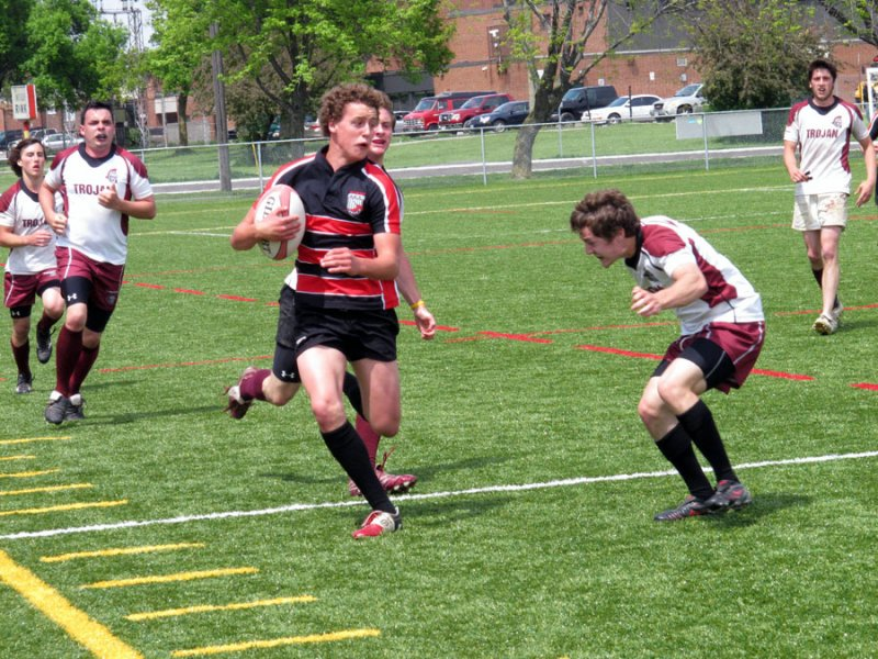 BELLEVILLE, ON (26/05/2011) COSSA Senior Rugby finals. Fenelon Falls players edges past Moira player. Photo by Steph Crosier