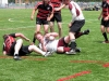 BELLEVILLE, ON (26/05/2011) COSSA Senior Rugby finals. Trojans prop taken out Falcons players. Photo by Steph Crosier