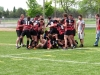 BELLEVILLE, ON (26/05/2011) COSSA Senior Rugby finals. Coach of the Fenelon Falls High School Falcons is tackled by his team after winning. Photo by Steph Crosier