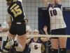 Lancer veteran Kristen Curtis (10) blocks a spike from Cambrian's Dakota Campbell in volleyball action on Sunday, Nov. 25. The Lady Lancers fell to the Golden Shield 3-0. Photo by Taylor Renkema.