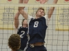 Lancer veteran Jared Moelker reaches to block the ball during a game against Fleming. Photo by Taylor Renkema.