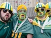 TORONTO, Ont. (25/11/2012) – Close friends and Edmonton Eskimos fans Marco Derosa, Max Bentley, Tyler Boykiw and Bryan Bartman (l-r) make their way to the Rogers Centre for the 100th game armed in their teams colours. They got their tickets last July and will be watching the game from the 600 level.  Photo by Julia McKay