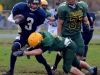 Saints running back #3 Evan Vance breaks a tackle as the Chargers #37 Jon Park looks on. Photo by Andrew Mendler
