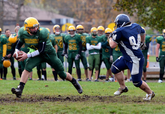 Chargers quarterback #1 Dylan Stavely-Watson scrambles as he tries to aviod a Quinte defender. Stavely-Watson only played in the first half of Centennials 31-7 semi-final victory over Quinte on Friday. Photo by Andrew Mendler