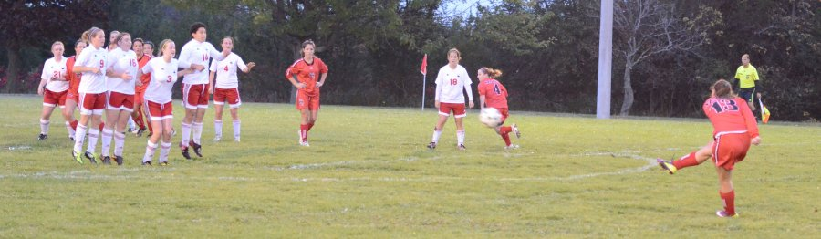 Seneca Sting Angela DeCarli (13) takes an indirect kick towards a wall of Lady Lancers. Photo by Taylor Renkema