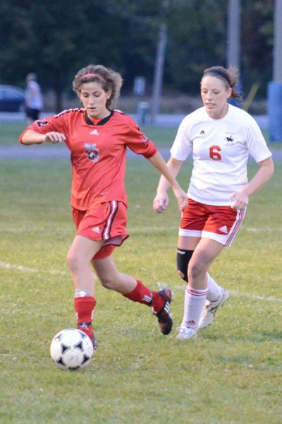 Loyalist Lancer Shelby Lough approaches Seneca's Hilda Chmait in Wednesday's game Photo by Taylor Renkema