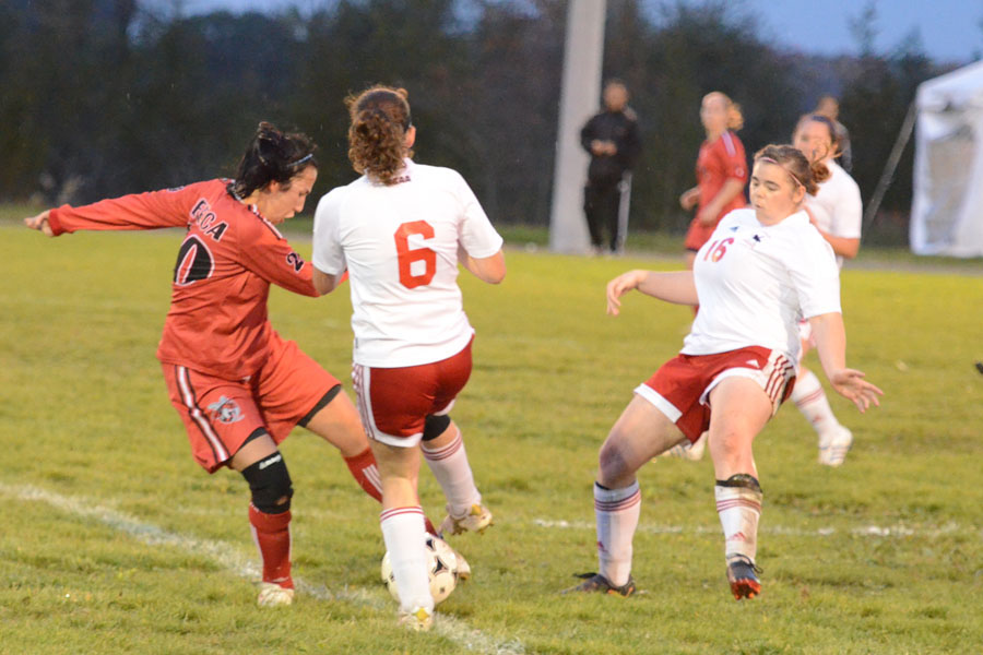 Lancers Shelby Lough (6) and captain Lisa Hill (16) fight with Sarah Donato (20) for the ball Photo by Taylor Renkema
