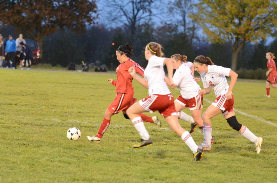 Lancers Stephanie Davenport (7), Lisa Hill (16) and Shelby Lough (6) chase Seneca's Sarah Donato for the ball (20) Photo by Taylor Renkema