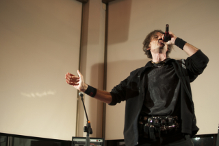 BELLEVILLE, Ont (13/10/11) - Dan Ouellette, a metal harmonicist, plays for the crowd in Alumni Hall Wednesday November 30th 2011. Oullette was just one of the acts on stage as part of the Benefit Concert for the Quinte and District Sex Assault Center. Photo by Andre Lodder
