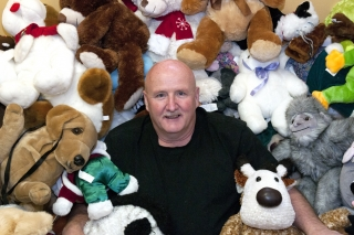 BELLEVILLE, Ont. (23/11/2011) - John Stephenson, retired firefighter and chairman of the Belleville Firefighters' annual Toy Drive nestles himself into the donated stuffed toys on Wednesday, Nov. 23, 2011. The drive collects toys for approximately 1,300 children in the local area. Donation dropoffs are at north end of the Sidney Street Avaya complex, Bay View Mall by the LCBO, Quinte Mall outside Toys 'R' Us and any city fire hall. Photo by Jessica Corriveau