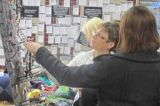 Colleen Ringham, co-ordinator of the continuing education program at Loyalist, and Administrative Co-ordinator for Corporate Training, Madeleine Norman, check out the hand crafted jewelery at the 10,000 villages Fair Trade Sale. The sale is at Loyalist December 7-9, 2011, and promotes fair trade- meaning the creators of these items get their fair share of the revenue.The Fair Trade Sale is organized by Loyalist's International Development students. Coffee, chocolate, artisan cheeses, along with hand-made jewelery, Christmas ornaments, and other knick-knacks are all for sale.Photo by Taylor Renkema.