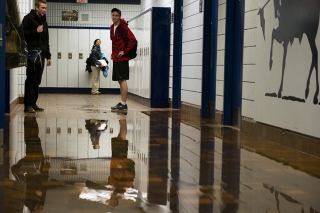 BELLEVILLE, Ont (14/01/13)- Loyalist College students watch as the athletic hallway fills with water coming from the women's change room. Photo by Richard Barclay.