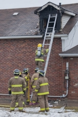 TRENTON, Ont. (02/01/2012): A fire at home in Trenton on Wednesday Feb 1 on 79 Ontario Street. Witness said black smoke started pouring out of the attic window and was then followed by huge flames. The owner was home but made it out of house after one of the co-workers, from Capelli Salon, which is adjacent to the home, banged on the door. Photo by Tristan Kong.