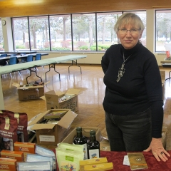 Christine Hammond is a volunteer with 10,000 Villages, who is selling jewlery, coffee, chocolates and small knick-knacks to raise money for Friends of Migrant Workers of Brighton. Photo by Mike Morris.