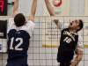 BELLEVILLE, Ont. (14/01/12) — Ian Hortop of the Loyalist Lancers tries to block the volley of Scott Anderson of the Cambrian Golden Shield during the men's volleyball game against the Loyalist Lancers held at Loyalist College in Belleville, Jan. 14, 2012. The Lancers defeated the Golden Shield 3-0. Photo by Melchizedek Maquiso.