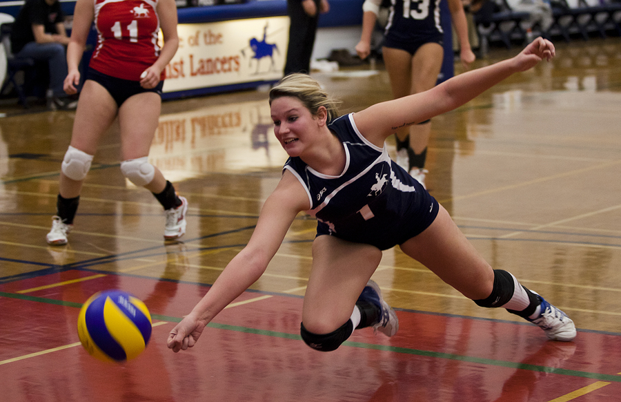 BELLEVILLE, Ont. (14/01/12) — Sherene Einarsson of the Loyalist Lady Lancers tries to save the ball from touching the ground during the women's volleyball game against the Cambrian Golden Shield in Belleville at Loyalist College, Saturday, Jan. 14, 2012. The Lady Lancers all three sets to top-seeded OCAA East Division Cambrian College. Photo by Melchizedek Maquiso.