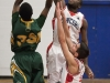 BELLEVILLE, Ont (31/01/12) - Calvin Chevannes and Matt Miller of the Loyalist Lancers attempt to block the shot of Kameron Cyril of the Fleming Knights during Tuesday's basketball game held at Loyalist College.  The Knights won 79-72.  Photo by Melchizedek Maquiso.