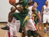 BELLEVILLE, Ont (31/01/12) - Brandon Chambers of the Fleming Knights battles for the rebound against Loyalist Lancers' Patrick Kalala and Calvin Chevannes during the first half of the men's basketball game held at Loyalist College.  The Knights won 79-72.  Photo by Melchizedek Maquiso.