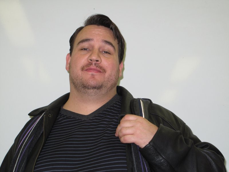 John Moodie a Journalism: Online, Print and Broadcast student, is showing off his Movember mustache. November 30, 2011.