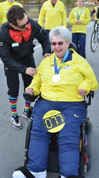 Karen Kitchen was the final medal bearer in Belleville's Rick Hansen relay. She wheeled the medal into the Quinte Sports Center and right up on stage where she said Hansen was 'one of her idols'. Kitchen serves on Belleville's Accessability Advisory Committee. Photo by Taylor Renkema