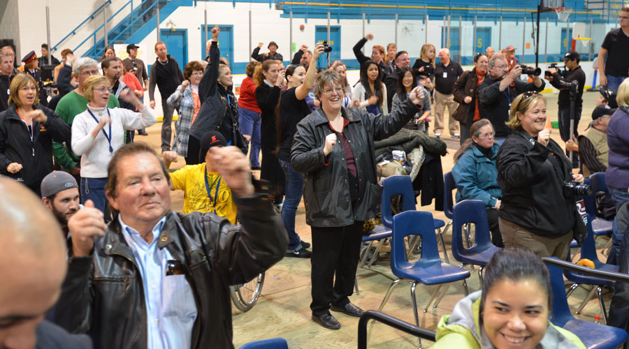 Audience members show their support for Rick Hansen at his speech at the Quinte Sports Center Monday.  Photo by Taylor Renkema