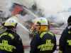 (TRENTON-11/05/2012) Paramedics look on as firefighters battle a blaze at the Sherwood Forest Inn on Monday morning. The building at 19 Murphy Street went up in flames after 9 a.m. Downtown Trenton was blocked off by police and smoke could be seen from Belleville. Photo by Marc Venema.