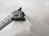 (TRENTON-11/05/2012) A firefighter battles a blaze at the Sherwood Forest Inn on Monday morning from one of two aerial trucks. The building at 19 Murphy Street went up in flames after 9 a.m. Downtown Trenton was blocked off by police and smoke could be seen from as far as Belleville. Photo by Marc Venema.