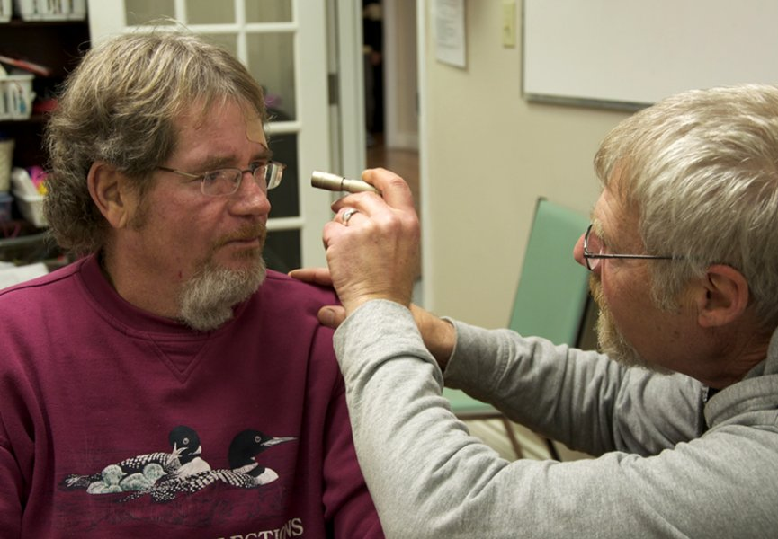 BELLEVILLE, Ont. (11/11/11)— After a minor biking accident, Doug Roy checks up on a clients injuries to make sure he did not have a concusion. Photo by Brynn Campbell.