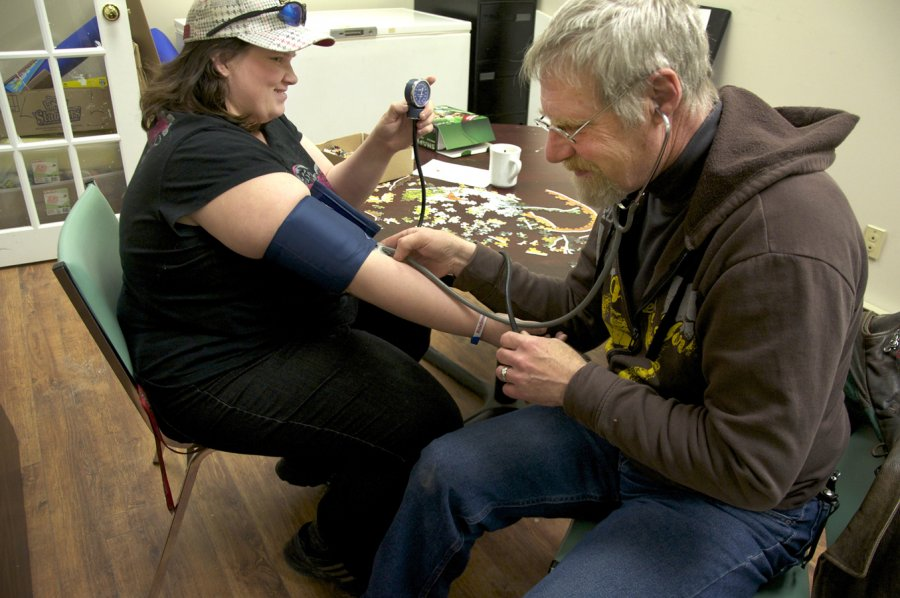 BELLEVILLE, Ont. (16/02/12)— Doug Roy checks Nicole Taylors blood pressure after she confronted Roy about frequent nose bleeds. Photo by Brynn Campbell.