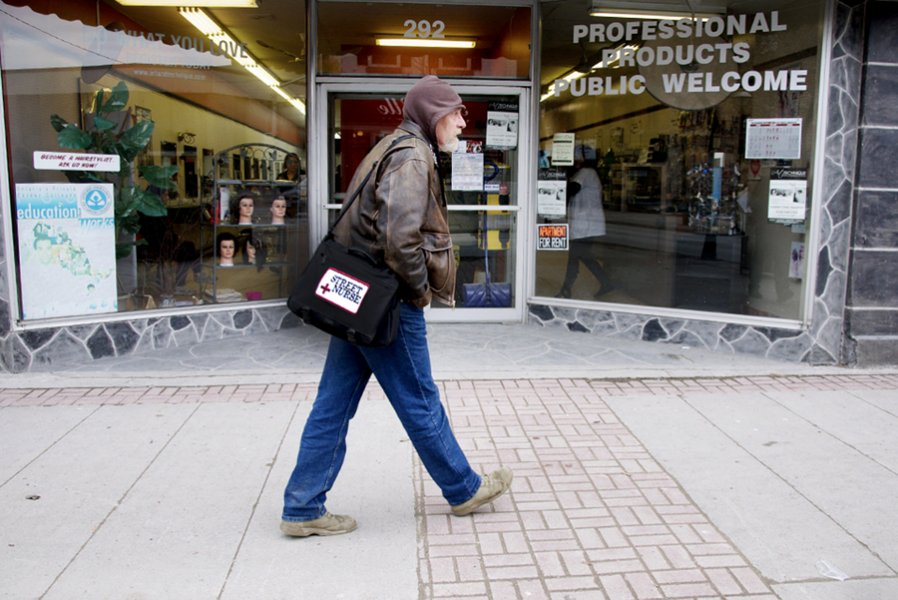 BELLEVILLE, Ont. (16/02/12)— Doug Roy walks along Front Street to check up on his clients in the area. Roy voluntarily started his job as a street nurse six years ago, where his help was welcomed by the people in the area. Photo by Brynn Campbell.
