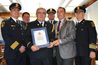 BELLEVILLE, Ont. (28/05/2012) Fire Prevention Officer Glenn Ellis (third from left) recieved a plaque of recognition at Monday's city council meeting after retiring from Belleville Fire Department after 30 years of service. Also pictured (from left) Fire Chief Rheaumé Chaput, Councilor Jackie Denyes, Deputy Fire Chief Mark MacDonald, Mayor Neil Ellis (brother) and Deputy Fire Chief Bruce Greatrix. Photo by Marc Venema.