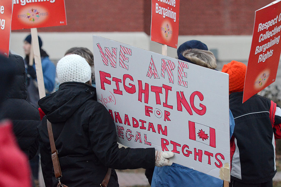 (BELLEVILLE) 11-12-2012 - A variety of faces and signs helped spread the message that educators don't agree with government legislation that takes away their right to negotiate their contracts. Photo by Keenan Weaver