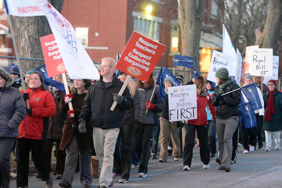 (BELLEVILLE) 11-12-2012 - The rally of solidarity marches from the education center and heads to the streetsto spread their message. Derek Watt (black coat in the front) is a teacher at Prince Charles Public School in Belleville, and came to the rally to express his support. Photo by Keenan Weaver