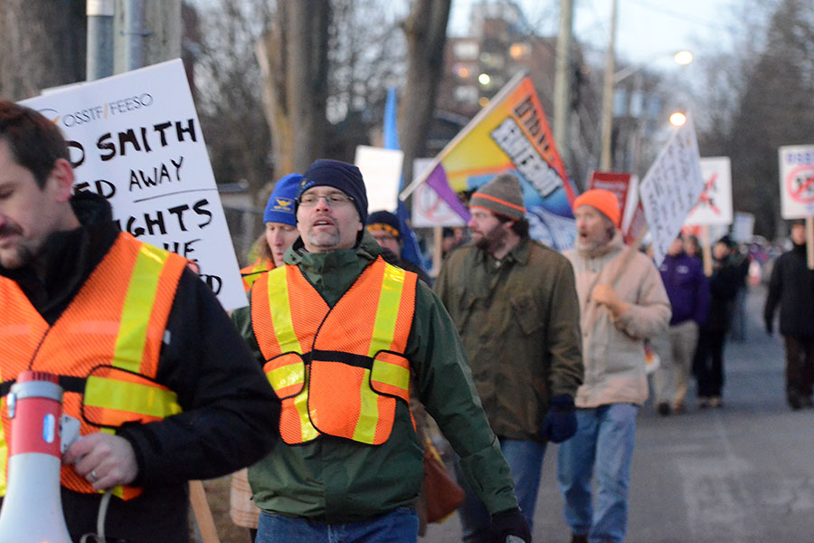 "(BELLEVILLE) 11-12-2012 - Rally ""marshalls"" lead the pack to Dundas Street, calling cheers of ""Hey hey, ho ho, Bill 115 has got to go. Photo by Keenan Weaver."
