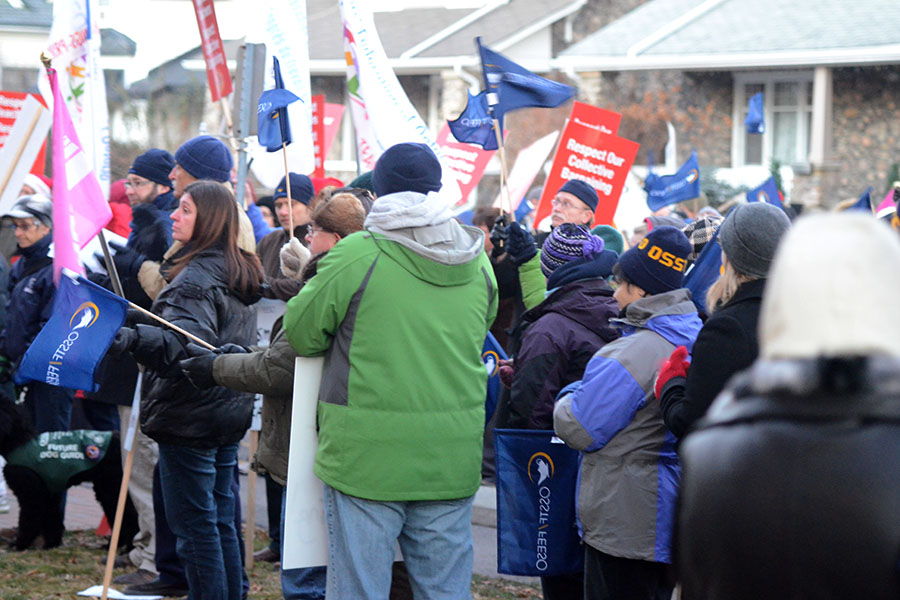 (BELLEVILLE) 11-12-2012 - Members of three separate unions listen intently to Karen Fisk speak about the government's actions and comments around Bill 115. Photo by Keenan Weaver