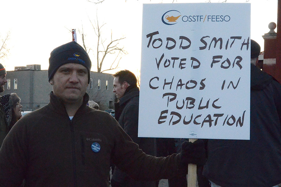 (BELLEVILLE) 11-12-2012 - Keith Sled, Vice President of the local OSSTF, prepares himself for Tuesday's rally, wearing his union attire and holding his sign with pride. Photo by Keenan Weaver