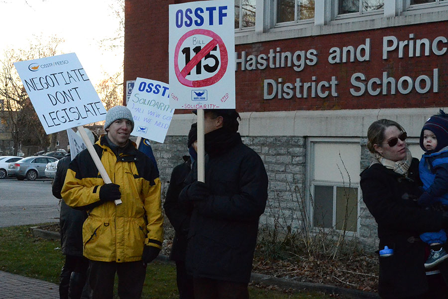 (BELLEVILLE) 11-12-2012 - Local secondary school teachers showed up to Tuesday's rally at the education center to show their support for their fellow educators. Photo by Keenan Weaver