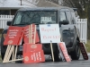(BELLEVILLE) 12-12-12 - A protester's car near Park Dale Public School is covered with extra signs for the one-day walkouts happening across the district. Photo by Keenan Weaver.