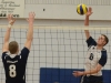 Lancer Jared Moelker spikes the ball past George Brown. Loyalist lost 3-1 to the Huskies. Photo by Taylor Renkema.