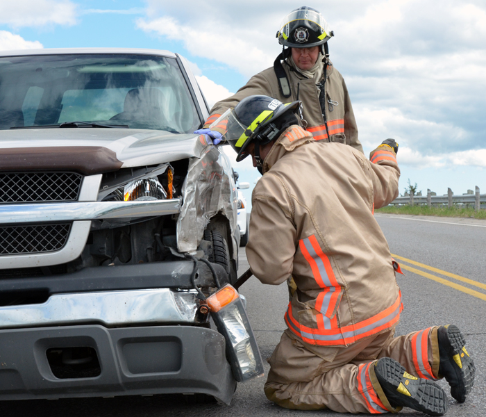 BELLEVILLE, Ont. (31/05/2012) Firefighters works on freeing the wheel of a vehicle involved in a collision on Wallbridge-Loyalist Rd. on Thursday afternoon. The two-vehicle collision happened just before 4 p.m. on the bridge near Moira St. West. There were no serious injuries. Photo by Marc Venema.