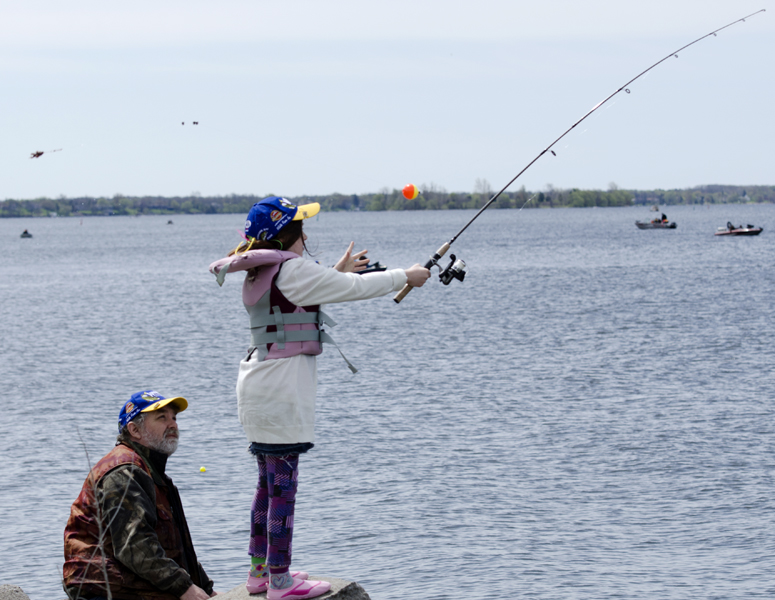 It was only the second time ten year old Niamh Flynn from Ottawa had been fishing. Her uncle Dave Smith was hoping one of the many walleye in the bay would bite her hook. Photo: Gail Paquette