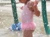 TRENTON, Ont. (21/07/11) Mayan Forsey-MacKinnon, 3, from Bayside, stands under a sprinkler at Trenton's Centennial Park splash pad. She came with her aunt to beat the heat. Photo by Renee Rodgers.