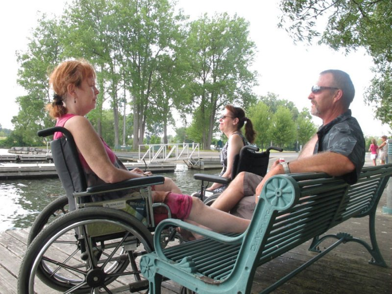 BELLEVILLE, Ont. (21/07/11) Jenni Hinchey (left), Mary Wannamaker (centre) and Dale Malcolm (right) enjoy the weather by the South George Street boat launch. The three are from Milton but came to Belleville for a doctor's visit. Photo by Renee Rodgers.