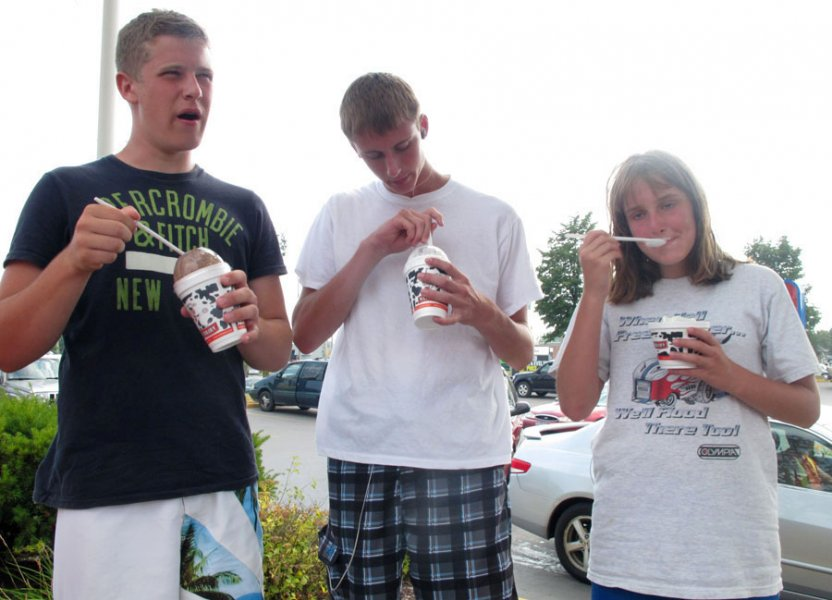 BELLEVILLE, Ont. (21/07/11) Tyler Graham, 16, from Brantford, (left) cools off with ice cream from Reid's Dairy with Bobby Kerr, 15, (centre) and Erin Kerr, 12, (right) both from St. George. The youths visited Belleville with their parents during a camping trip near Stirling. Photo by Renee Rodgers.