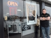 BELLEVILLE, Ont. (02/15/13) - Manager Juliano Akleh is infront of his shop standing next to a legendary tattooist who stopped by all 7 of the Wild Ink locations. A proud moment for the business.